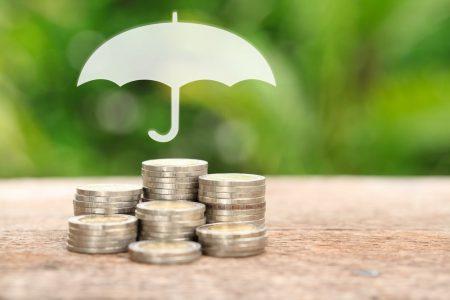 Picture of money under umbrella
